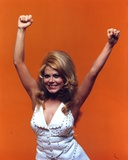 Charo Posed in Orange Background Photo by  Movie Star News