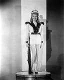 Betty Grable Posed with Hands on the Side in White Long Sleeve Silk V-Neck Shirt with Black Collar  Photo by  Movie Star News