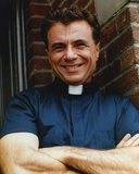 Robert Blake smiling in Priest Shirt Photo by  Movie Star News