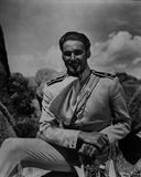 Errol Flynn smiling in Classic Photo by  Movie Star News