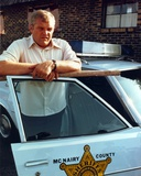 Brian Dennehy Leaning on Police Car Photo by  Movie Star News