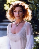 Amy Irving Looking at the Camera wearing a White Dress with a Necklace in Portrait Photo by  Movie Star News