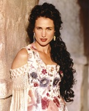 Andie MacDowell Leaning on the Wall wearing a Floral Dress with Earrings Photo by  Movie Star News