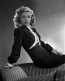 Gloria DeHaven posed On A Chair in Black Formal Dress in Black and White Photo by  Movie Star News