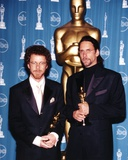 Coen Brothers Holding Trophy in Black Tuxedo Photo by  Movie Star News