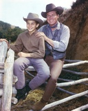 Laramie Cast sitting on Rail Ranch in Cowboy Outfit Photo by  Movie Star News