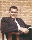 Jeffrey Hunter Seated in Striped Suit Photo by  Movie Star News