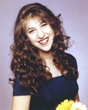 Mayim Bialik smiling in Portrait Photo by  Movie Star News
