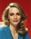 Peggy Lipton smiling in Blue Dress Portrait with Red Background Photo by  Movie Star News