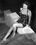 Mala Powers on a Halter Dress and sitting Photo by  Movie Star News