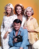 Robert Vaughn Holding a Camera in Yellow Background Photo by  Movie Star News
