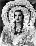 Jeanette MacDonald Portrait in White Long Sleeve Ruffled Dress with White Waist Ribbon and White El Photo by  Movie Star News