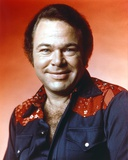 Roy Clark Portrait in Red Background Photo by  Movie Star News