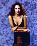 Melina Kanakaredes Leaning on a Wooden Post in Black Dress Photo by  Movie Star News