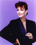 Margaret Colin smiling in Black Dress with Earrings Photo by  Movie Star News