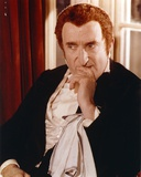 Ron Moody Posed in Black Suit Portrait Photo by  Movie Star News