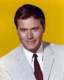 Larry Hagman Portrait in Yellow Background Photo by  Movie Star News