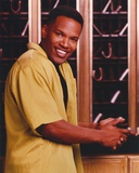 Jamie Foxx smiling wearing Yellow Polo Portrait Photo by  Movie Star News
