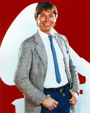 John Denver standing in Formal Suit Photo by  Movie Star News