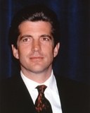 John Kennedy wearing a Black Suit and a Glossy Necktie in a Close Up Portrait Photo by  Movie Star News