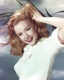 Piper Laurie Posed in a Portrait while Holding Hair in White Sweater Photo by  Movie Star News