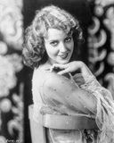 Jeanette MacDonald Seated on a Chair in White Sheer Long Sleeve Blouse with Right Elbow Bent and Ri Photo by  Movie Star News