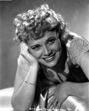 Penny Singleton smiling with One Hand on Face in Floral Dress Close Up Portrait Photo af Movie Star News