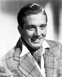 John Payne wearing a Checkered Suit in a Classic Portrait Photo by  Movie Star News