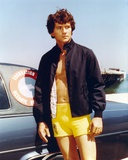 Patrick Duffy standing in Swimming Trunks with Black Jacket Photo by  Movie Star News