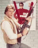 Marc Singer Side View Posed in Leather Vest with Rifle Portrait Photo by  Movie Star News
