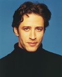 Jon Stewart smiling in Portrait Photo by  Movie Star News