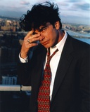 Peter Gallagher Posed in Black Suit with Red Tie Photo by  Movie Star News