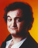 John Belushi Orange Background Close Up Portrait Photo by  Movie Star News
