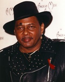 Neville Aaron Neville Aaron Neville - in Black Jacket With Hat Portrait Photo af Movie Star News