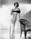 Myrna Loy standing in Off Shoulder Dress Photo by  Movie Star News