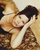 Marcia Harden Lying on Bed in Black Dress Photo by  Movie Star News