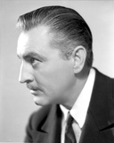 John Barrymore wearing a Suit in a Close Up Portrait Photo by  Movie Star News