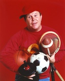 Ned Beatty posed in Red Background Photo by  Movie Star News