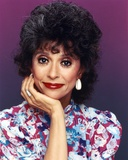 Rita Moreno smiling in Floral Dress Portrait Photo by  Movie Star News