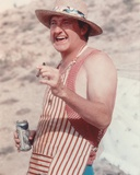 Randy Quaid smiling while Holding Cigar and Beer Photo by  Movie Star News