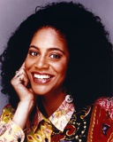 Kim Coles Leaning Chin On Hand in Gray Background Photo by  Movie Star News