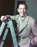 Milton Berle smiling on a Ladder Photo by  Movie Star News