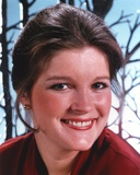 Kate Mulgrew smiling in Red Dress Portrait Photo by  Movie Star News