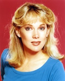 Julia Duffy wearing a Blue Tunic and Earrings in a Close Up Portrait Photo by  Movie Star News