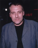 Tom Sizemore smiling in Blue Coat Portrait Photo by  Movie Star News