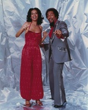 Marilyn McCoo standing in Dress With Man Photo by  Movie Star News