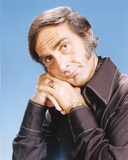 Sid Caesar wearing a Black Coat in Blue Background Photo by  Movie Star News