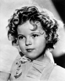 Shirley Temple wearing a Cap-Sleeve White Dress in Close Up Portrait Photo by  Movie Star News