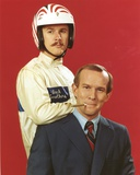 Smothers Brothers One Smoking a Cigar and the Other wearing a Helmet Photo af Movie Star News