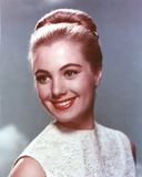 Shirley Jones Close Up Portrait in White Sleeveless Silk Dress with Back Knot Hair in Blue Backgrou Photo by  Movie Star News